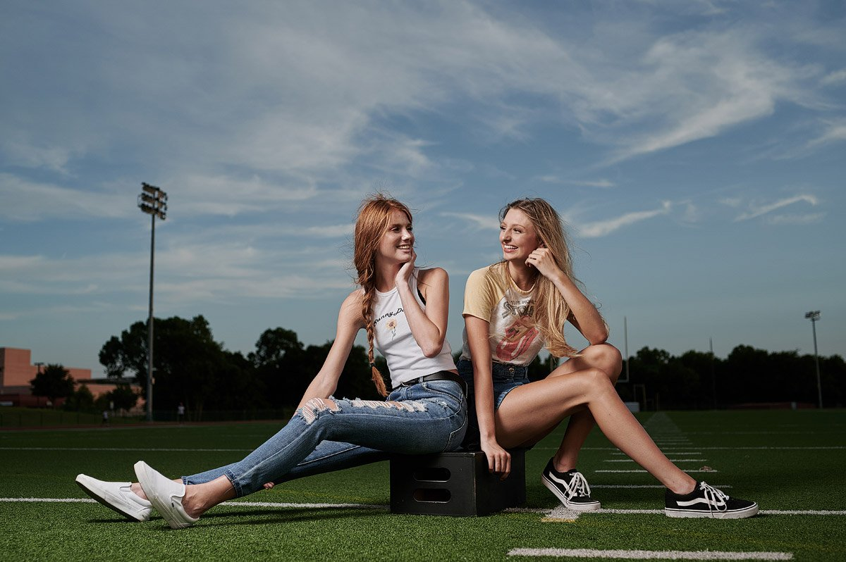 dallas cheerleaders friends for senior portraits in casual jeans and vintage t-shirts