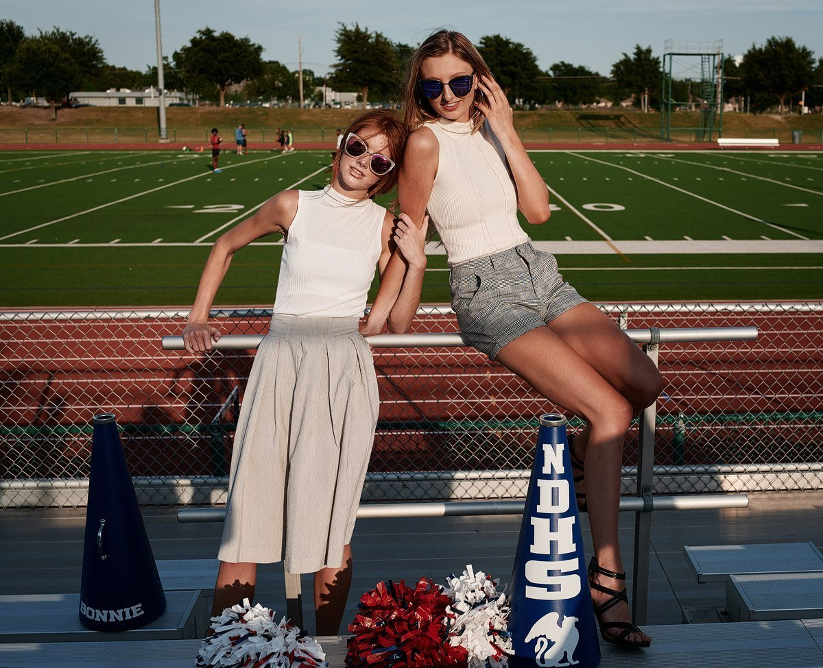 two dallas cheerleaders posing for pictures for senior portraits