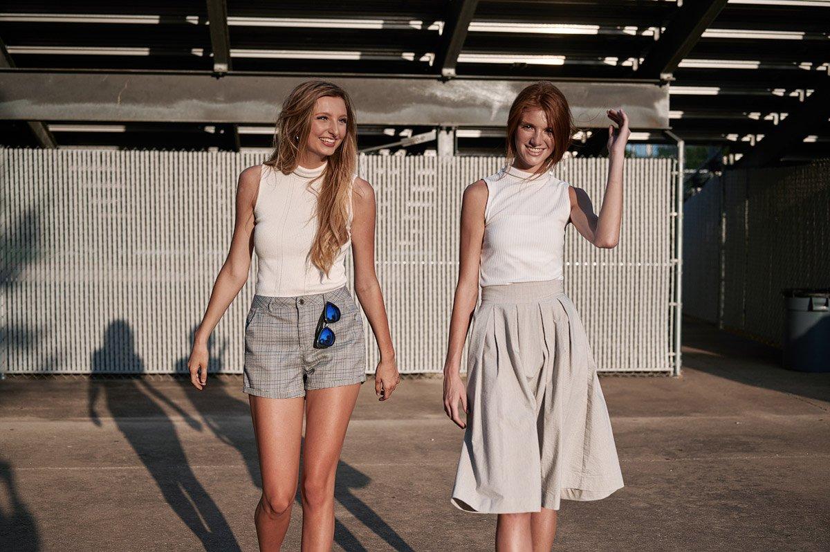 two cheerleaders walking under the bleachers for allen senior pictures