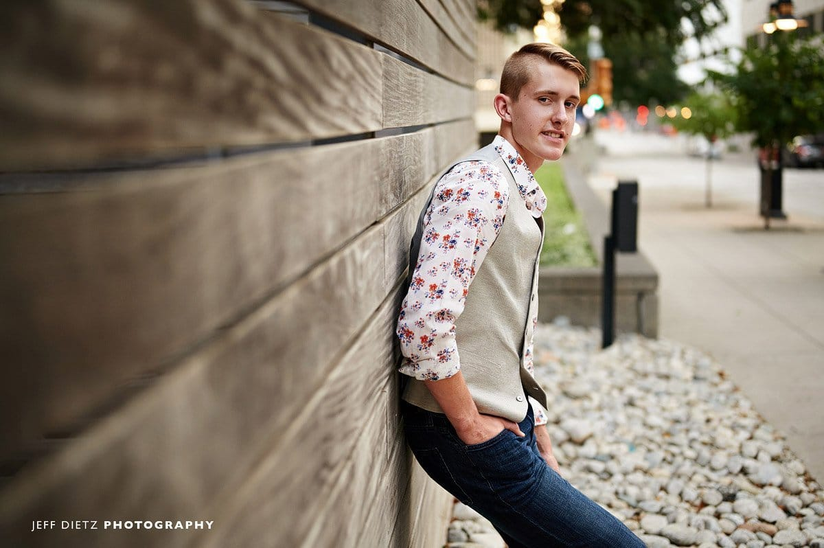 frisco liberty senior boy in a relaxed outfit jeans and vest downtown dallas