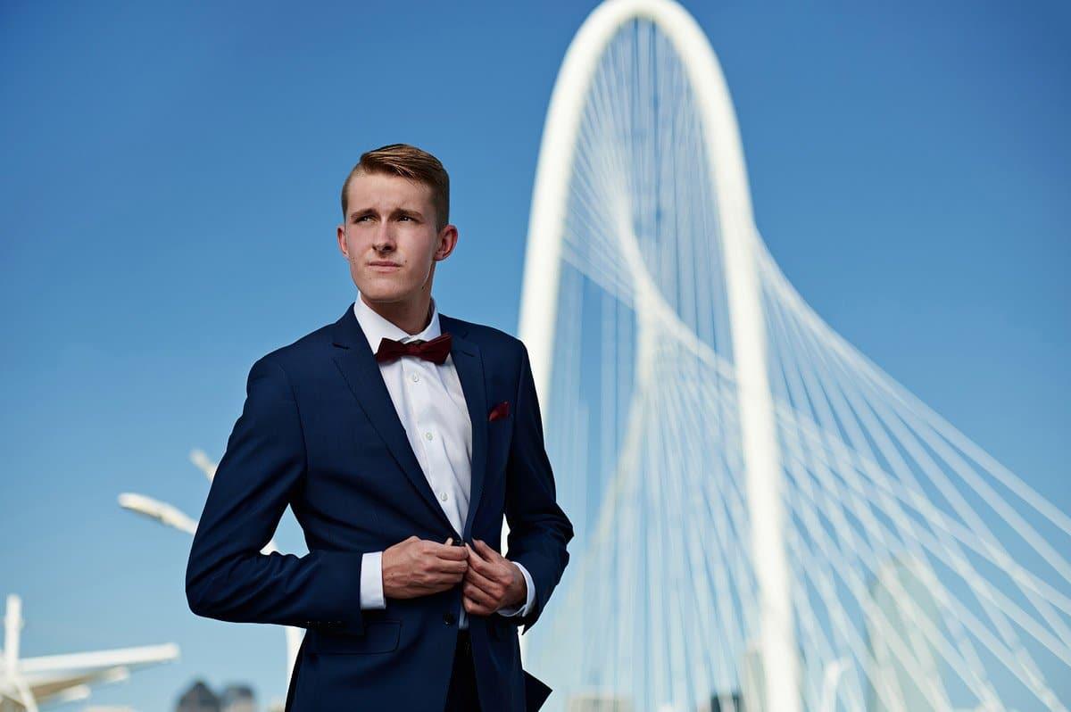 frisco liberty senior pictures in dallas blue suit hunt hill bridge