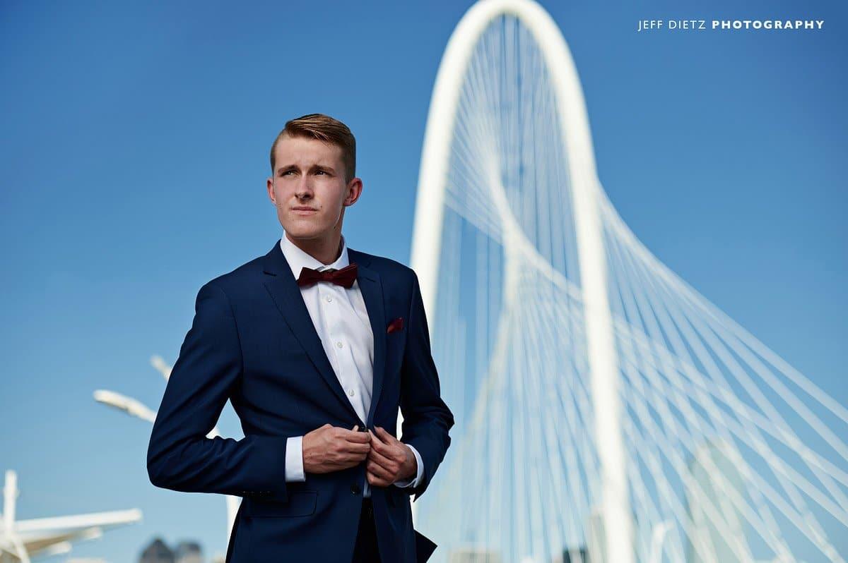 frisco liberty senior pictures in dallas blue suit hunt hill bridge in background