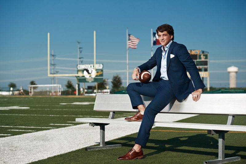 Legacy Christian Senior Portraits of Eagles Football player in blue suit