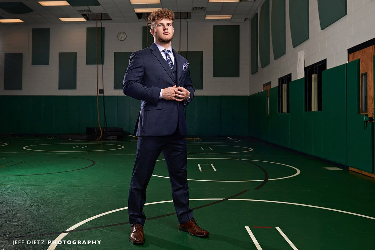 dallas wrestling senior portraits in the gym with a suit