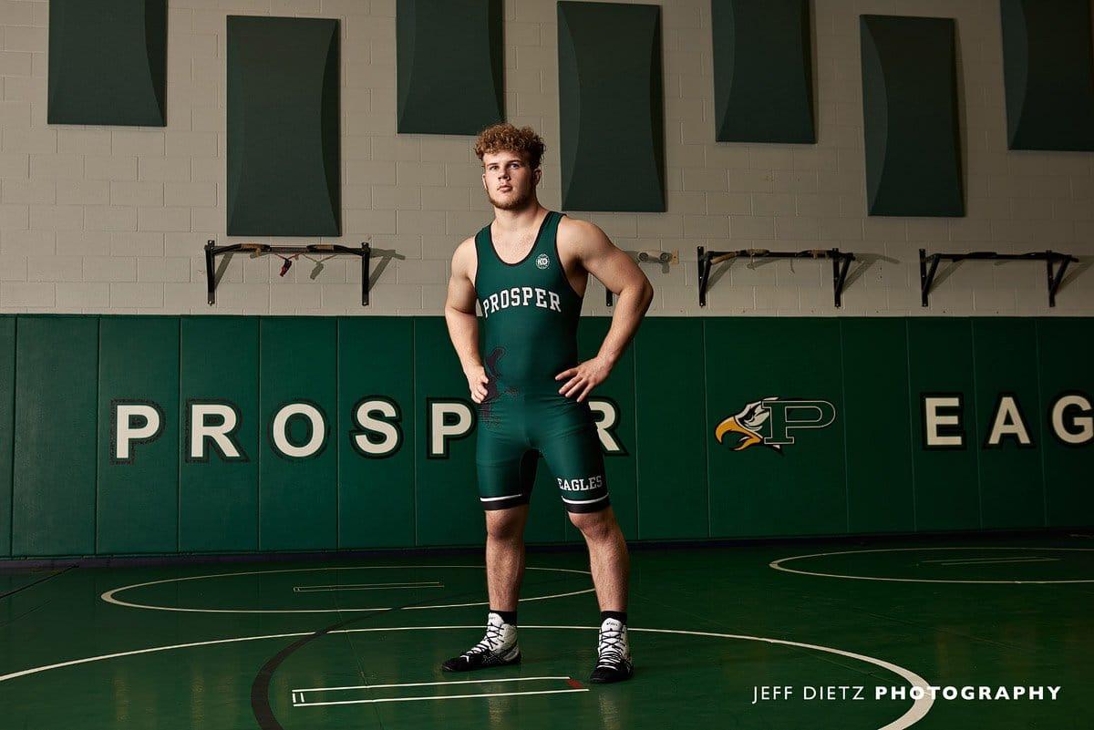 prosper senior wrestler in a singlet in the gym for senior pictures