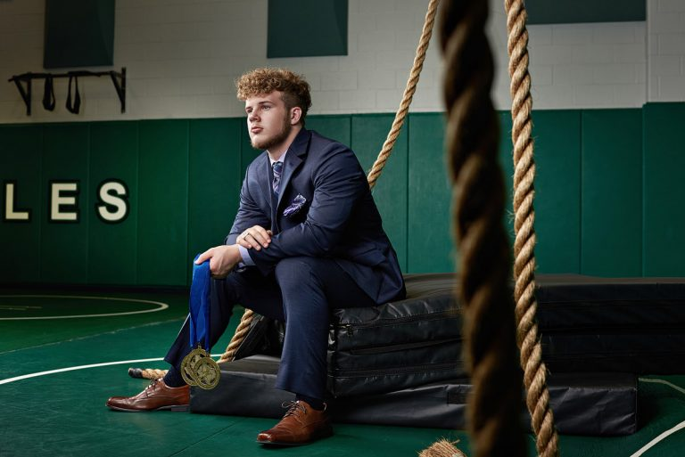 Prosper Wrestling senior sports portrait in the high school wrestling room texas