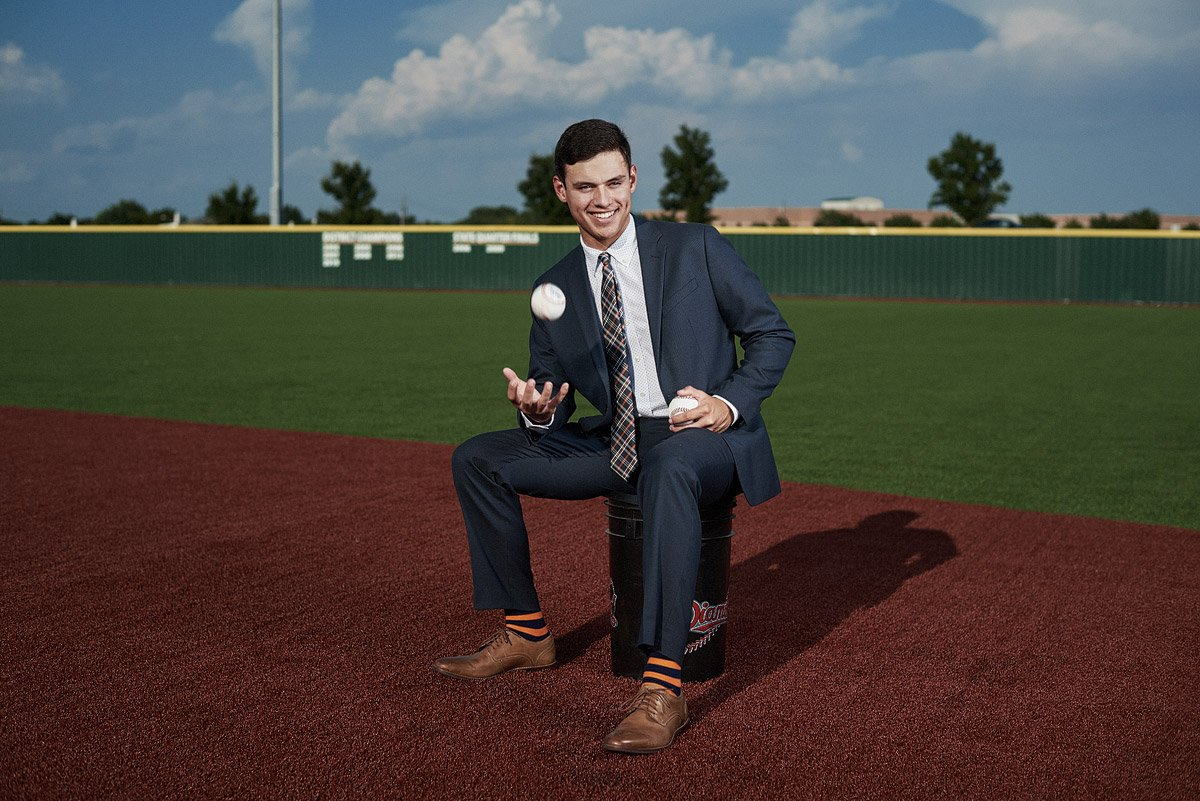 McKinney north senior baseball bulldogs in a suit for senior pictures