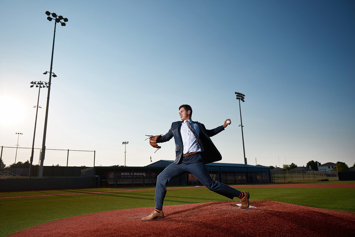 Mckinney north senior baseball pitching from the mound in a suit
