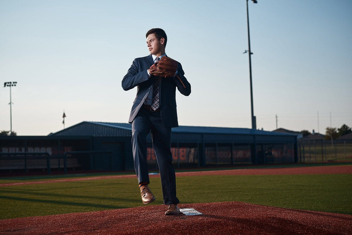 Mckinney north senior pitcher throwing from the mound in a suit