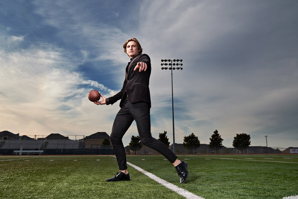 Prestonwood Senior Portraits of christian academy wide receiver football player in a suit