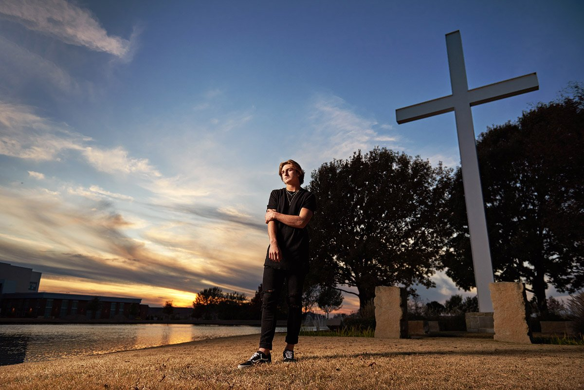 Prestonwood Christian Academy Senior Pictures in plano with cross at sunset