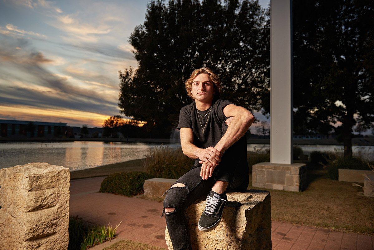 Casual prestonwood senior portraits in plano by lake in black jeans