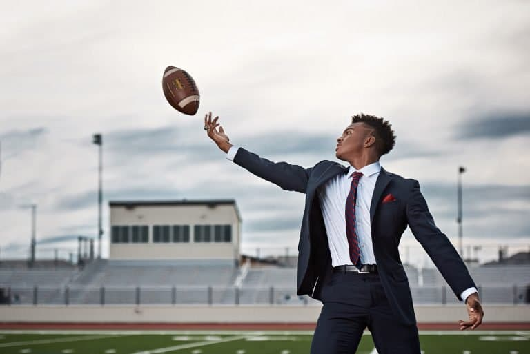 Frisco senior portraits memorial high football wide receiver catching ball