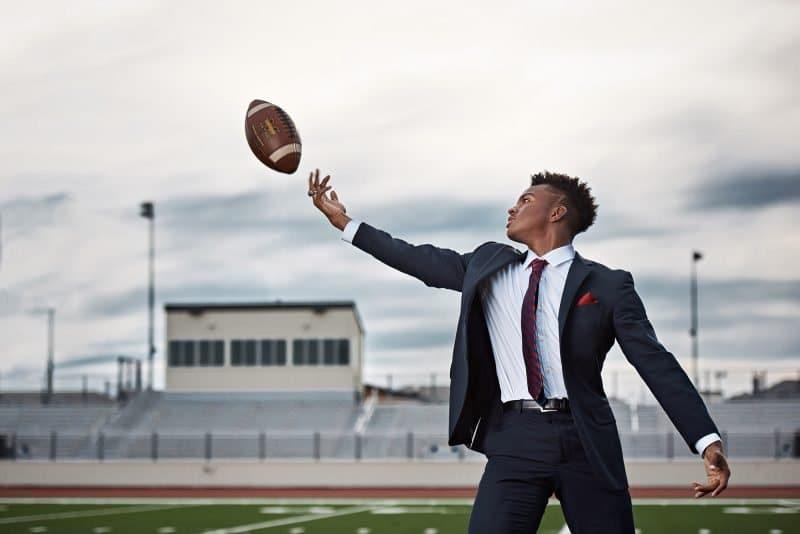 Frisco senior portraits memorial high football wide receiver catching ball