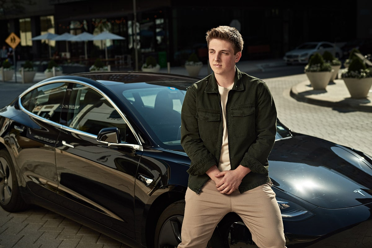 Mckinney senior poses with a tesla by dallas photographer