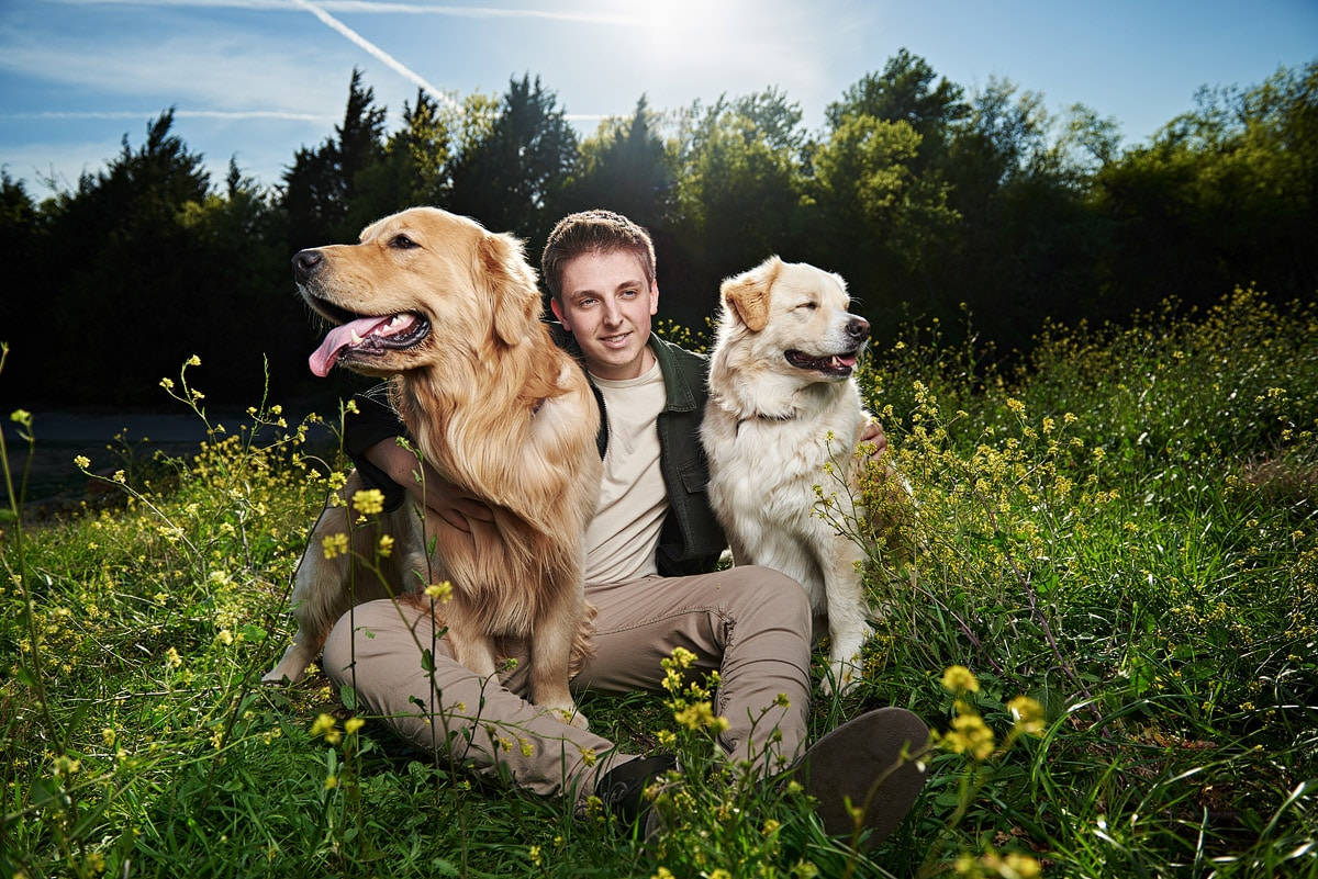 mckinney boyd senior poses with two dogs at arbor hills
