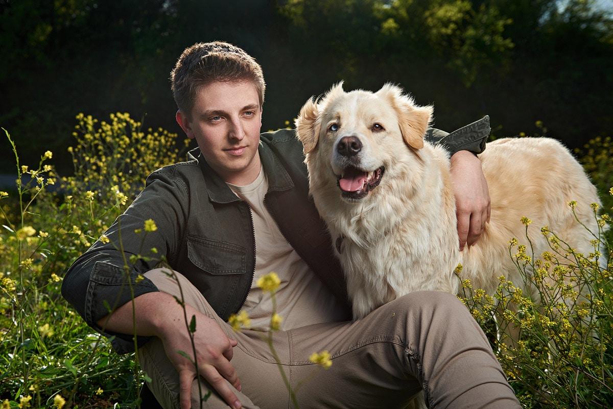 mckinney body senior poses with white dog at arbor hills plano texas