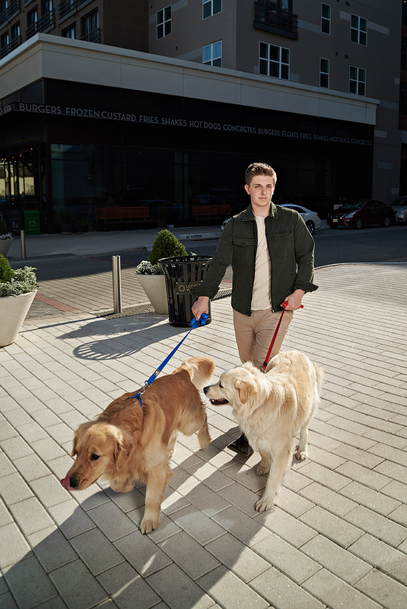 Mckinney Boyd senior with 2 dogs for photos at shops at legacy plano