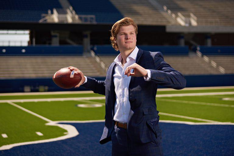 mckinney senior pictures football quarterback in stadium