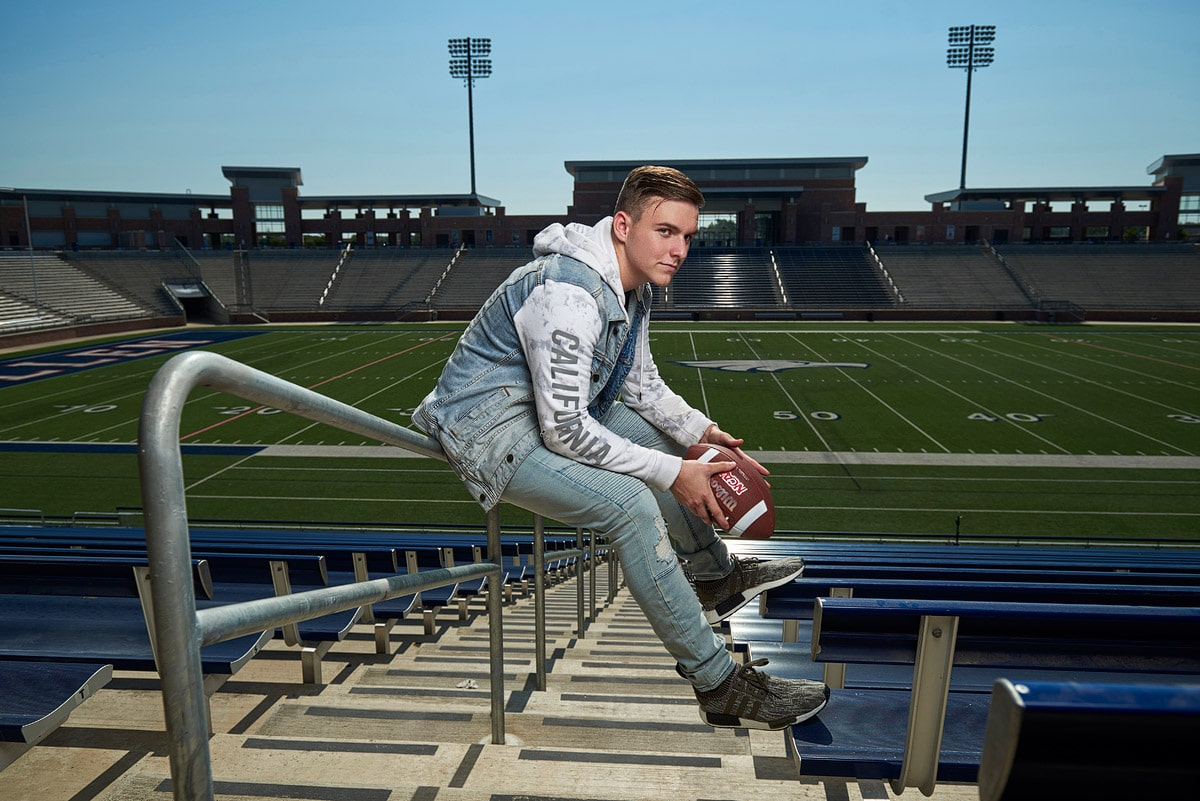 mckinney senior pictures of football player in stadium for info page