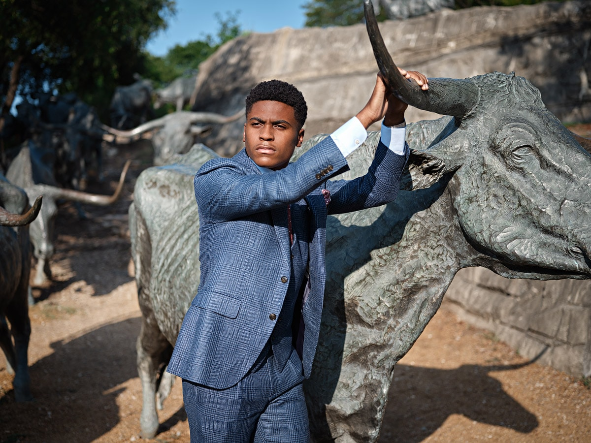 Fort Worth Christian senior portraits with steers in pioneer plaza dallas texas boys senior