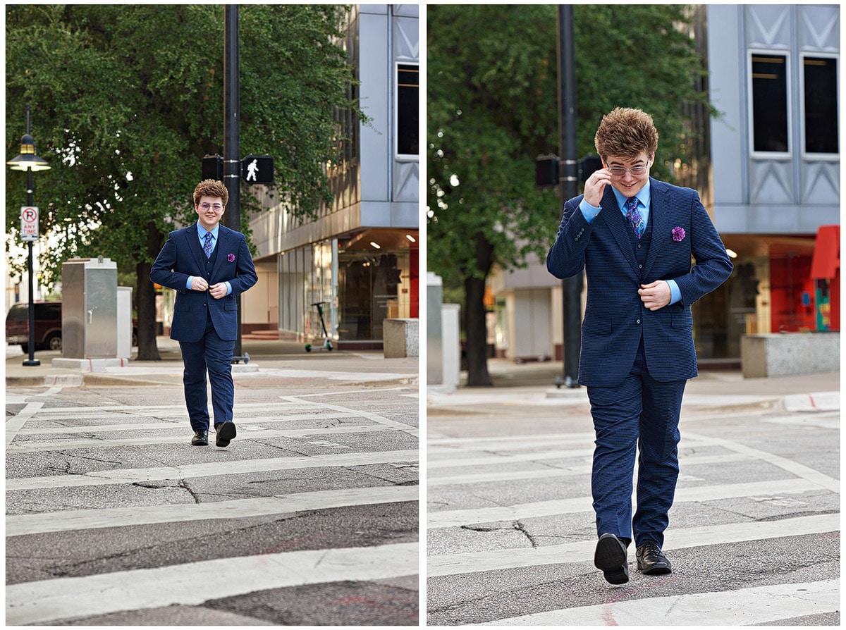 prosper senior portrait of zane in downtown dallas texas walking across street