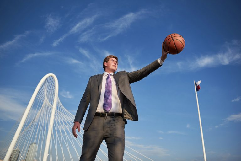 Richardson Senior Portraits of basketball player on the kirk bridge in Dallas Texas