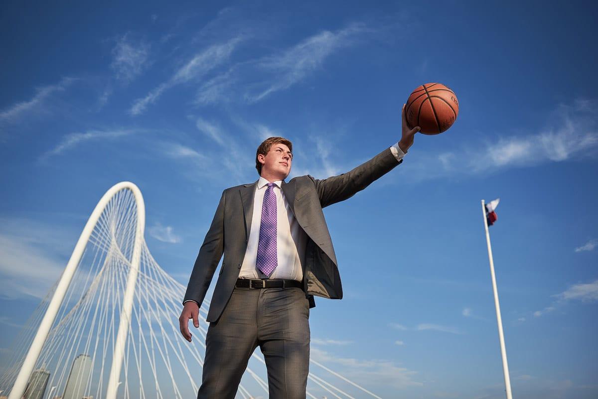Richardson Senior Portraits of basketball player on the kirk bridge in Dallas Texas